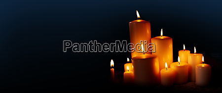 burning candles in the dark night