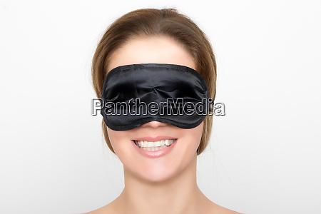 gorgeous woman with black sleep mask