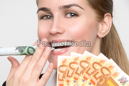 beautiful laughing woman smokes a rolled