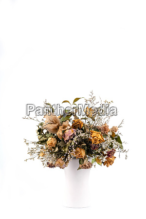 dried flowers in white vase