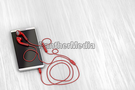 smartphone and red earphones