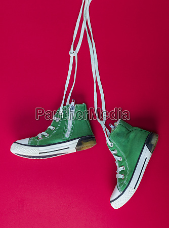 pair of worn textile sneakers with
