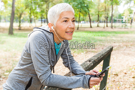 senior woman relax listening music with