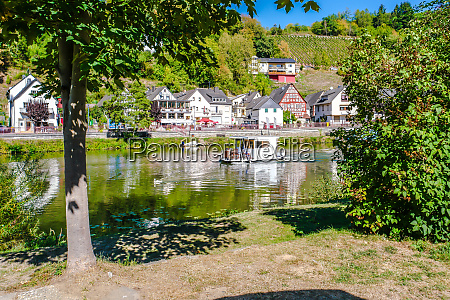 idyllic lahn river with houseboat