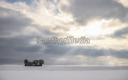 sun rays through clouds and snowy