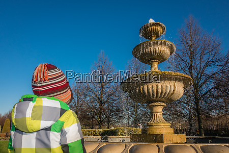 little boy looking at the fountain