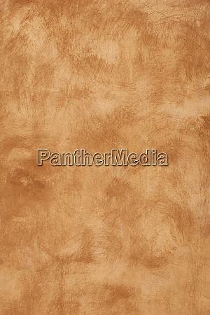 grunge beige brown painted plaster wall