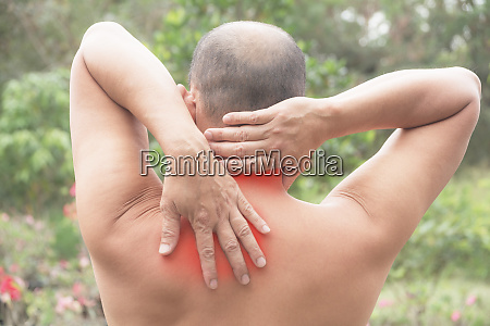 man suffering from neck and shoulder