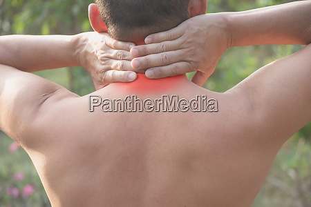 man suffering from neck pain acute