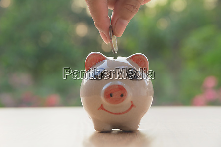 hand of man holding coin and