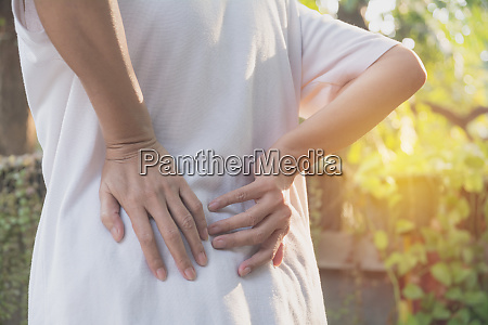 a woman suffering from backache spinal