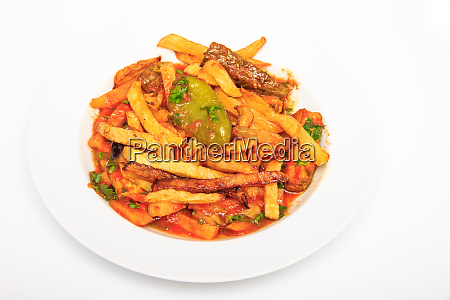 fried fries with paprika and tomato