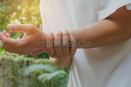 male holding wrist pain in a