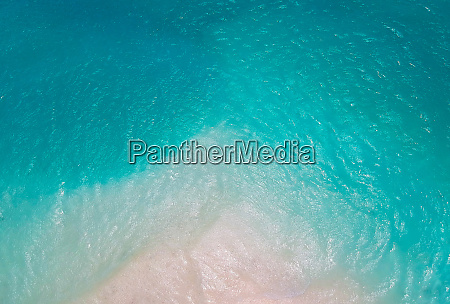 lonely sandy beach with turquoise ocean