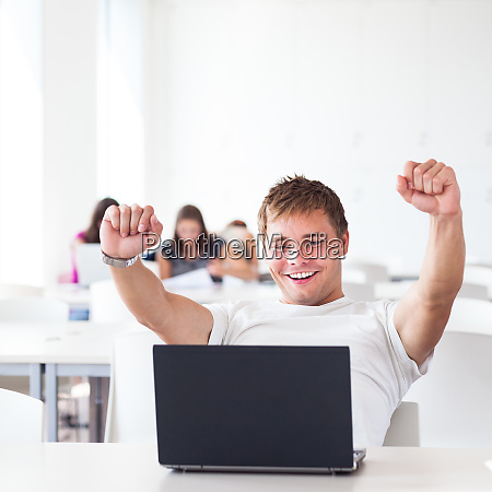 handsome college student with laptop computer