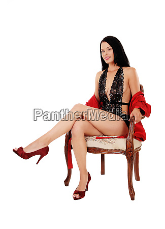 beautiful woman sitting in an old