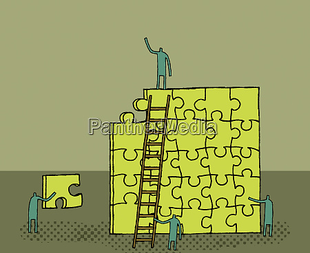 workers building puzzle