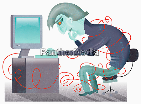 man at computer in tangle of