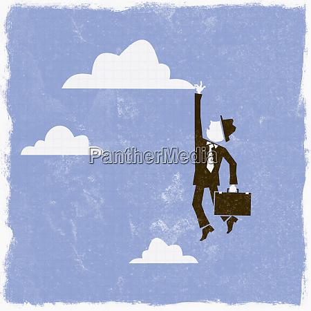 businessman reaching for cloud