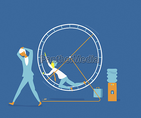 exhausted businessman in exercise wheel next