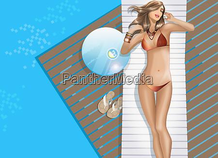 sexy woman in bikini talking on