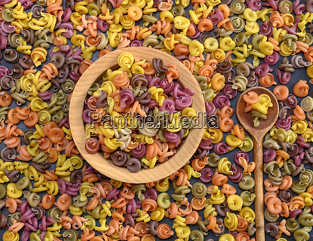 multicolored spiral raw pasta fusilli in