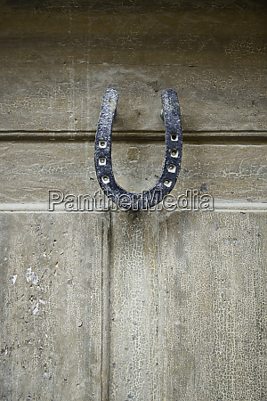 wooden door with horseshoe