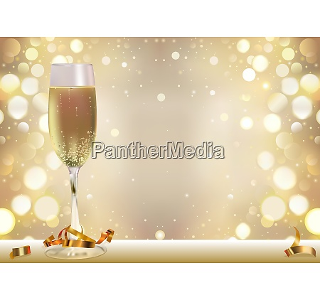 golden bokeh background with champagne glass