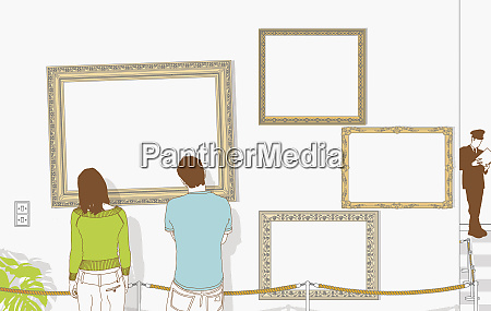 couple looking at empty frames in