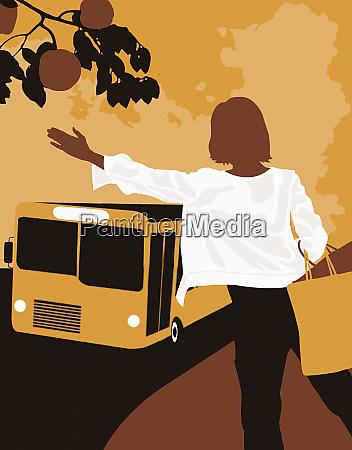 woman waving at bus
