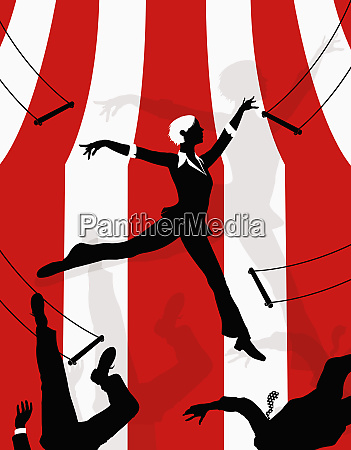 businesswoman swinging on trapeze