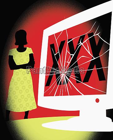 woman looking at cracked computer monitor