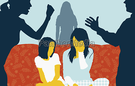 children on sofa between couple arguing