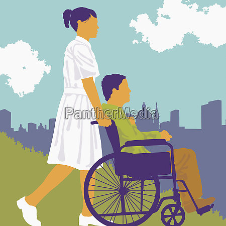 nurse pushing patient in city park