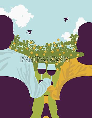 couple drinking wine in backyard