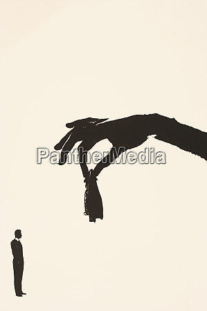 hand holding coat above man