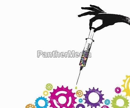 hand holding syringe with money symbols