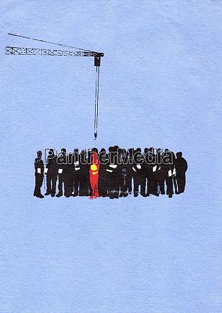 crane hook above businessman standing out