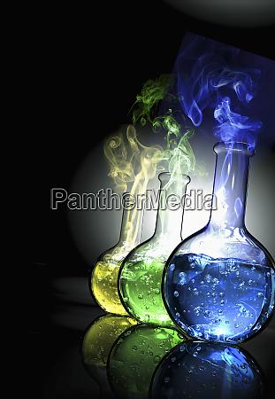 beakers with smoking liquid