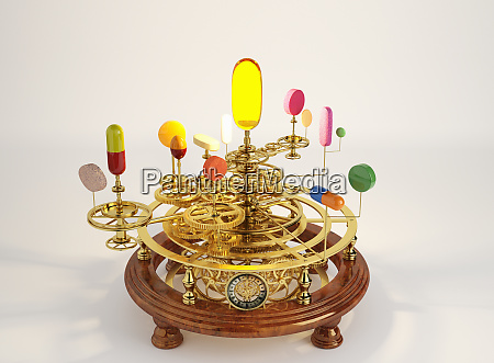 pills and capsules on clockwork orrery