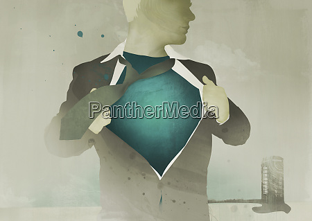 businessman revealing superhero costume under suit