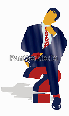 pensive businessman sitting on question mark