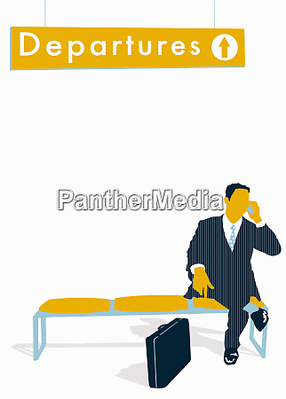 businessman talking on cell phone below