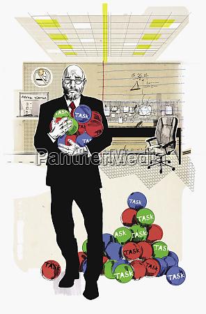 businessman holding armful of task balls