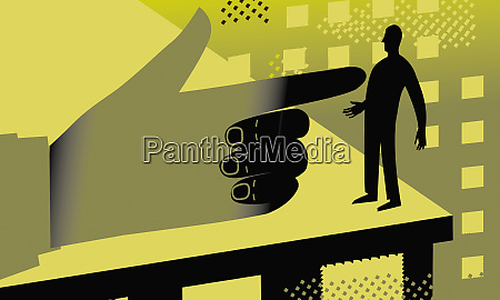 large hand point at businessman on