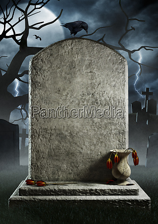 blank gravestone with dead flowers in
