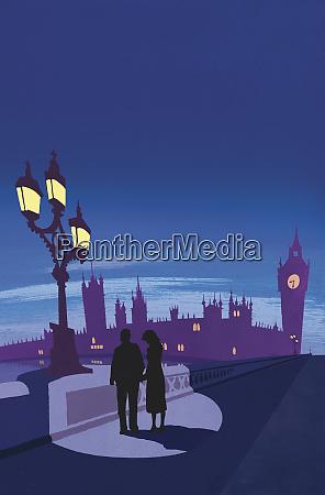 couple holding hands on london bridge