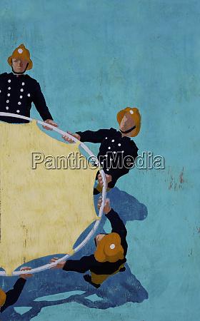 firemen holding rescue trampoline