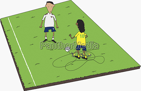 boys playing soccer on field