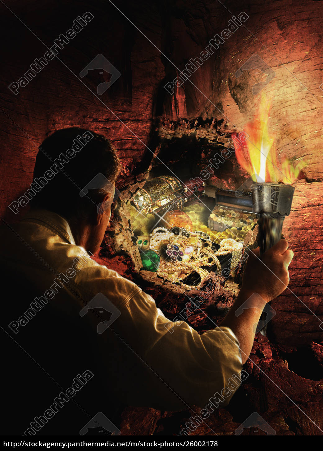 man, with, torch, uncovering, buried, treasure - 26002178